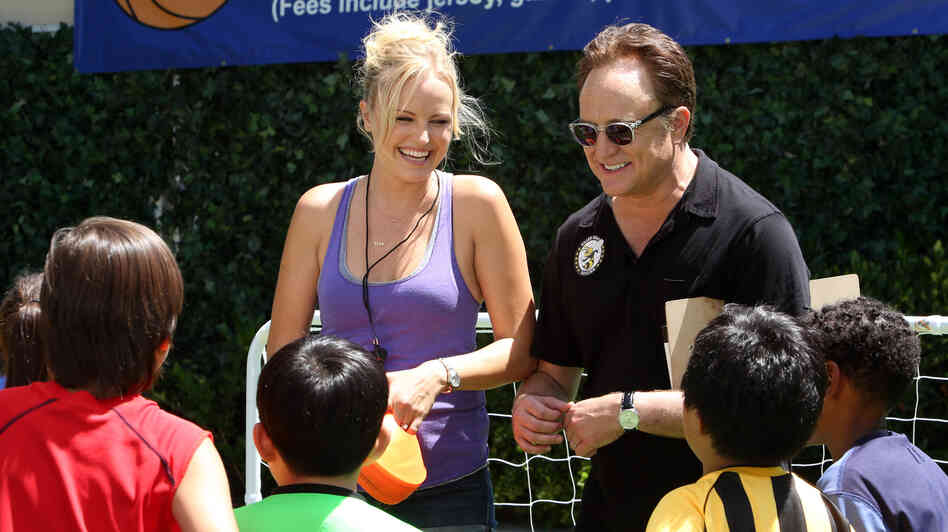 Kate (Malin Akerman) pitches in alongside husband Pete (Bradley Whitford) on her stepson's soccer practice in ABC's Trophy Wife.
