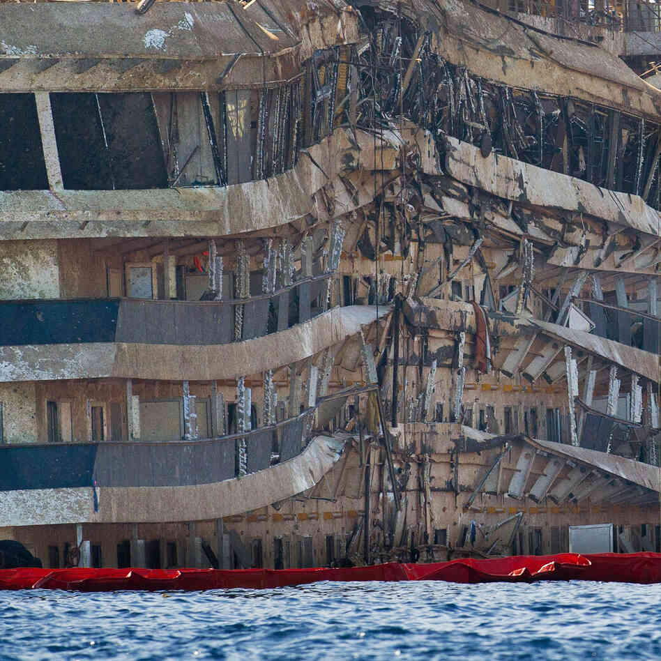 Part of the previously submerged, severely damaged right side of the Costa Concordia cruise ship is seen in an upright position last week after it was righted by salvage crews in Isola del Giglio, Italy.