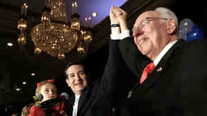 Republican Ted Cruz (left) raises his hand with his father, Rafael, while holding his daughter Caroline during a victory speech in November 2012.