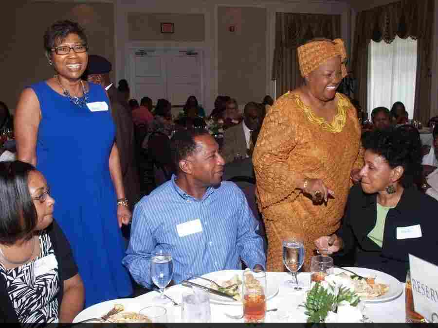 Carol Fowler (in blue dress) at the dinner her family turned into a charity event after her daughter's wedding was canceled.