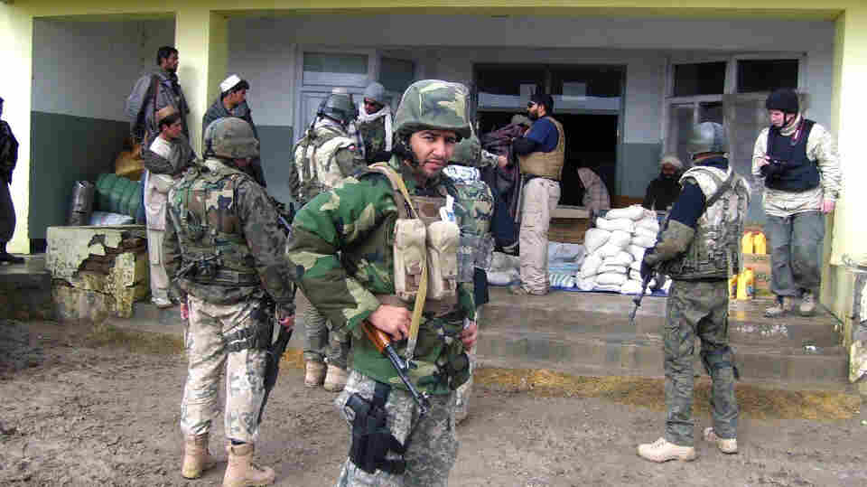Janis Shinwari is seen wearing his body armor in 2008. Shinwari, an Afghan interpreter who assisted U.S. forces, has been waiting three years for a visa to enter the United States. He is now in hiding in Afghanistan.
