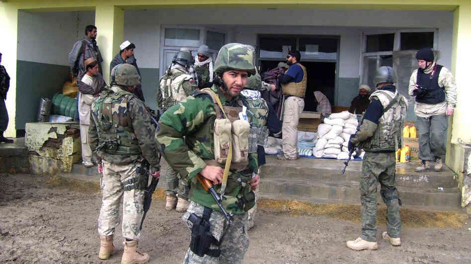 Janis Shinwari is seen wearing his body armor in 2008. Shinwari,