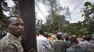 Kenyans watch Monday as a plume of black smoke rises over the Westgate Mall, scene of a terrorist attack that left more than 60 dead. Kenya is a crossroads in East Africa, has many links to the West and has sent troops into Somalia. For all these reasons, the country was targeted by Somalia's al-Shabab militia group.