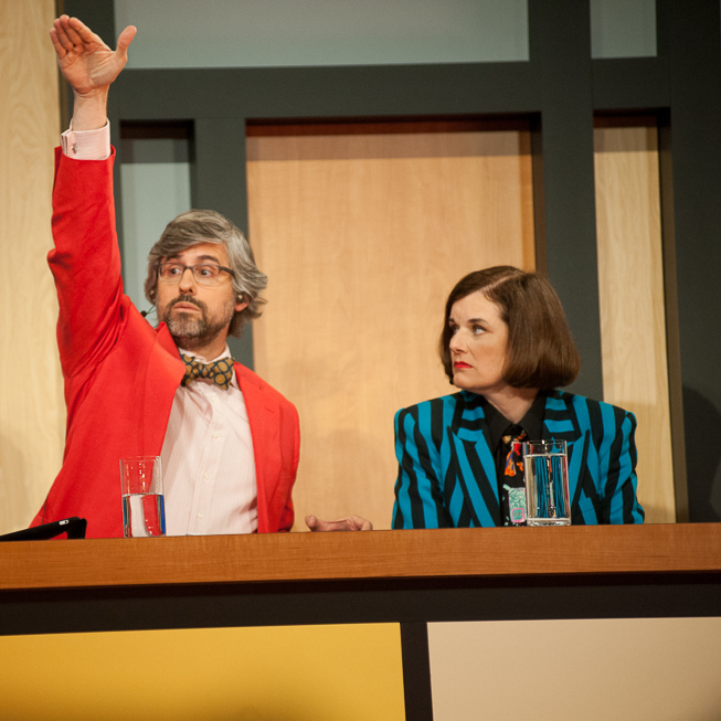 Host Peter Sagal (l) chats with regular panelists Mo Rocca and Paula Poundstone (c-r) during the show's live cinecast.