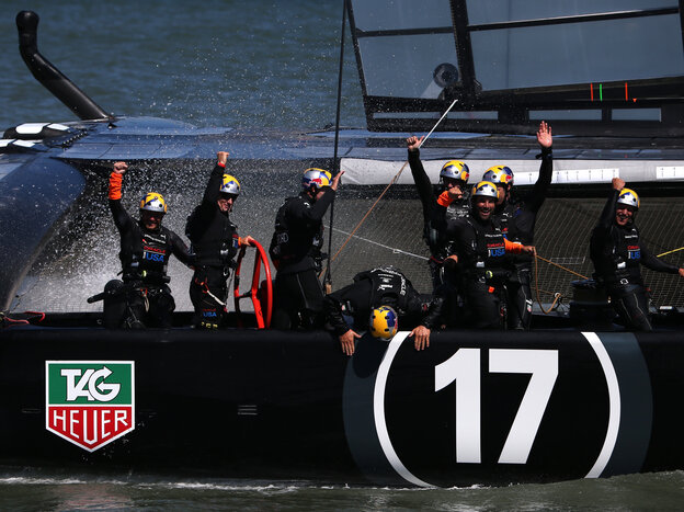 Oracle Team USA skippered by James Spithill celebrates after defending the cup as they beat Emirates Team New Zealand in the fina