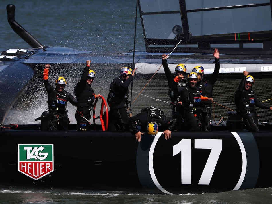 Oracle Team USA skippered by James Spithill celebrates after defending the cup as they beat Emirates Team New Zealand in the final race on Wednesday.