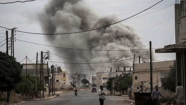 Smoke rises after an airstrike hit a Syrian village on Sept. 22.