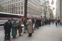People form a line on 5th Avenue extending around the corner as they wait for the U.S. Passport Office to open in New York's Rockefeller Center, Nov. 13. With the clock ticking toward a midnight shutdown, President Clinton vetoed a temporary borrowing bill and prepared to close most government operations.