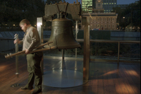 With Philadelphia's Independence Hall in the background, Park Service employee Matt Ifill gathers up the poles that surround the Liberty Bell at closing time on Dec. 13. With many government services scheduled to close down at midnight, Ifill and other workers there planned to report to work but were uncertain as to what they would do.