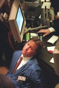 A trader on the floor of the New York Stock Exchange rests his head, on Nov. 13. Uncertainty about the impending government shutdown pushed down stock prices that day.
