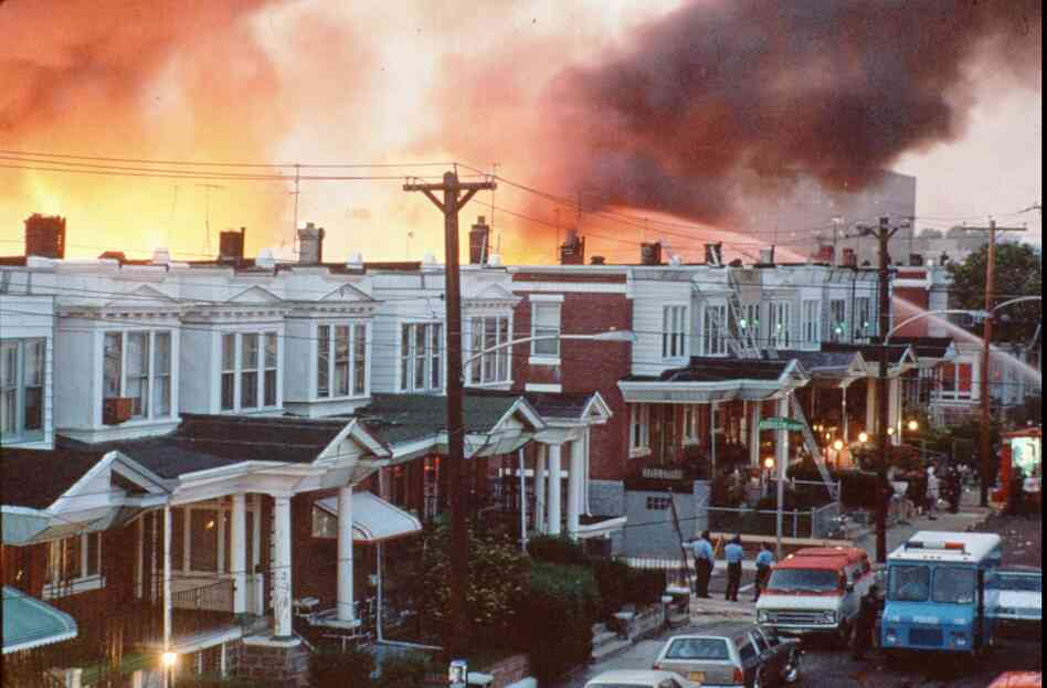 Row houses in Philadelphia burn after officials dropped a bomb on the MOVE house in this May 1985 photo from files.