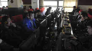 "Chinese authorities go to great lengths to censor the Internet and control social media. A 16-year-old was recently arrested under a new law that bars ""rumormongering"" online. Here, customers use computers at an Internet cafe in Hefei, China, in 2012."