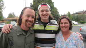Tyler Engel with his parents, Dave and Jennifer. His doctor and therapist worked with the family to help Tyler recover from a concussion.