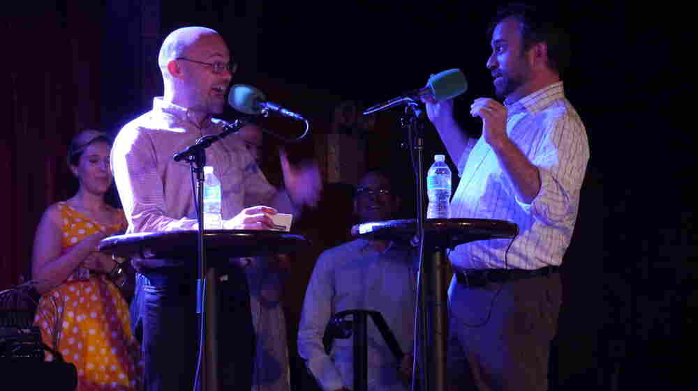"Adam Davidson and Robert Smith of NPR's Planet Money explain economic terms,€"" Taboo-style,€"" on stage at The Bell House in Brooklyn, NY."