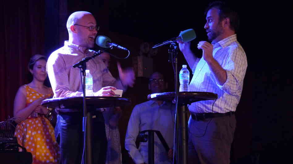 """Adam Davidson and Robert Smith of NPR's Planet Money explain economic terms,€"""" Taboo-style,€"""" on stage at The Bell House in Brooklyn, NY."""