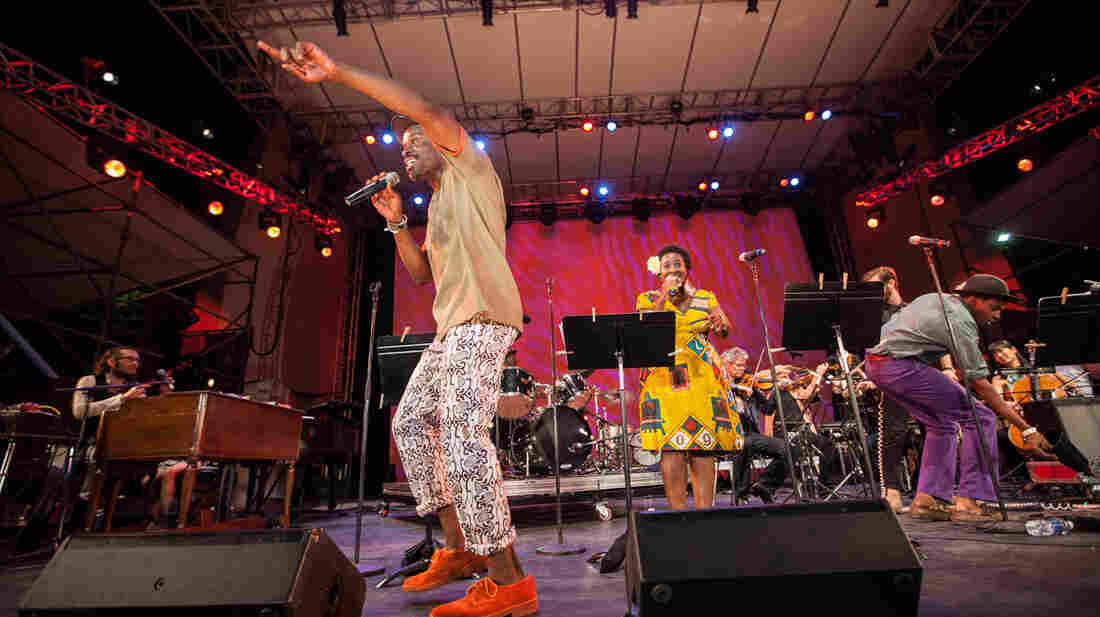 Kronos Quartet performs with Sahr Ngaujah (front) and Abena Koomson (center) at New York's Lincoln Center. Red Hot + Fela, a compilation album, comes out Oct. 8.