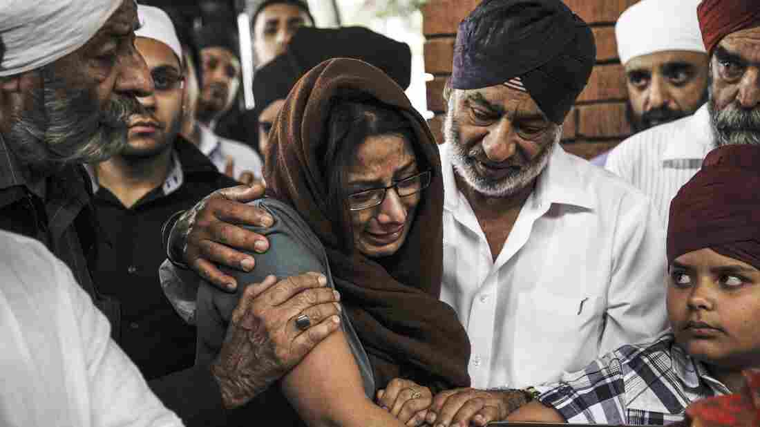 Members of the Kenyan Sikh community gathered in Nairobi on Wednesday to cremate a grandmother and son who were killed when terrorists took over the Westgate Mall.