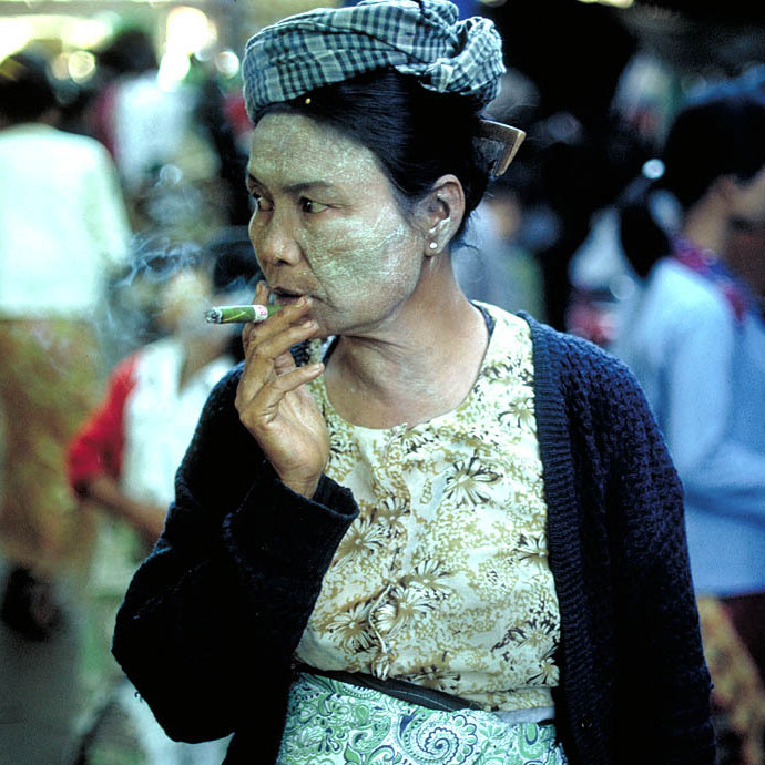 Woman smoking cheroot, Mandalay