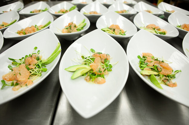 A salad of sunflower sprouts, grapefruit, and avocado waits to be served and eaten at a party in Washington, D.C.