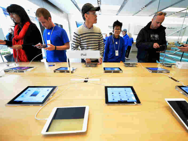 Customers test out iPad minis on display in Los Angeles. Students who received free iPads from the Los Angeles Unified School District in a deal with Apple are finding ways to use them for more than just classwork.
