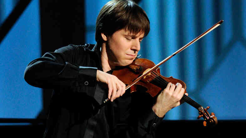 Joshua Bell is the violin soloist at the glittering opening night of Carnegie Hall's 2013-14 season.
