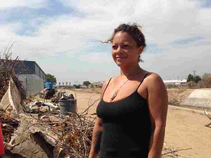 """Cinnamon, as she's called, serves as the de facto """"mayor"""" of a homeless encampment of an estimated 60 people near Fresno's downtown. It's not a place for children, she says, but overall, as a single woman, she feels safe there."""