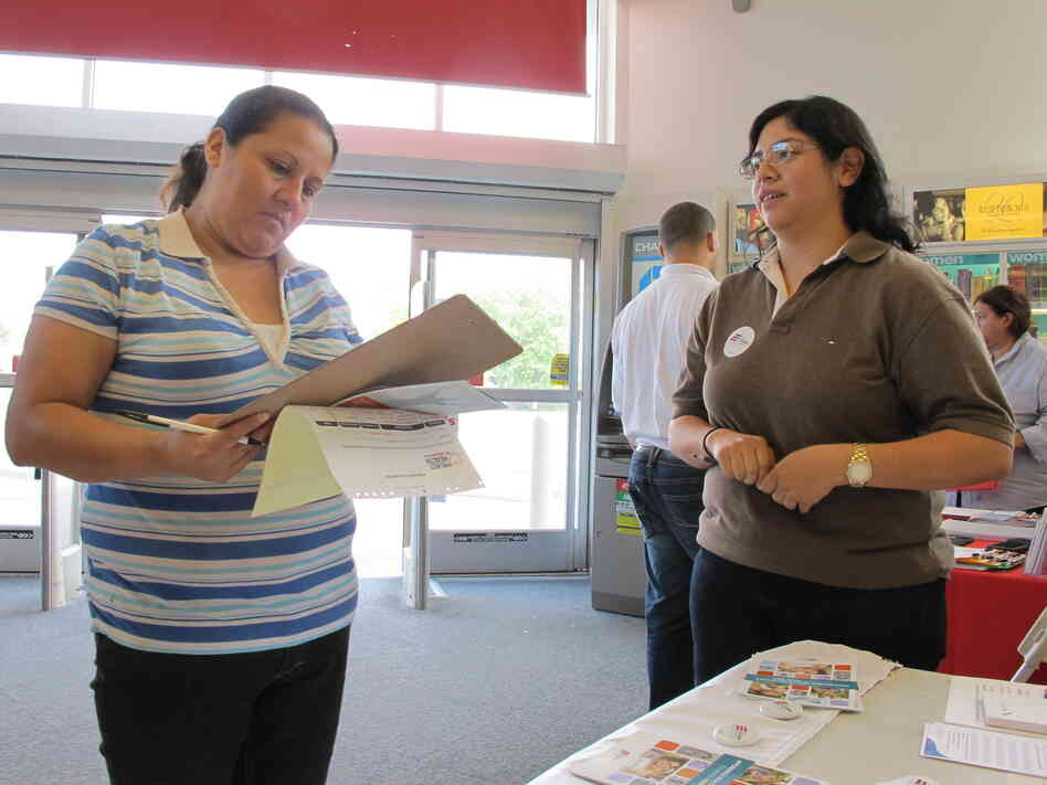 Enroll America outreach worker Rosy Mota (right) talks about the fed