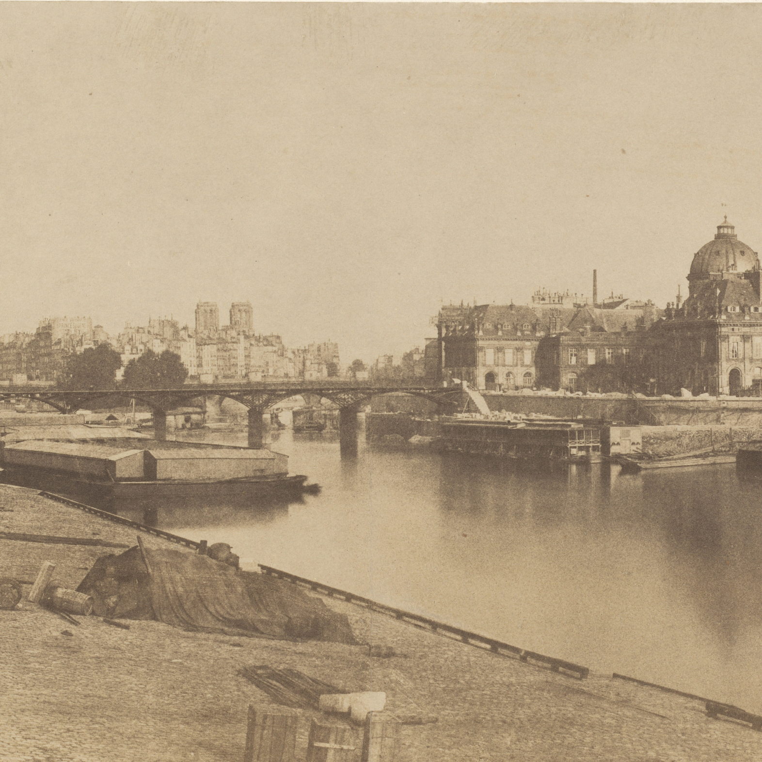 This 1854 Marville print shows a new wing of the Louvre being built (left), and the Seine before it underwent its own transformation. Click here to enlarge.