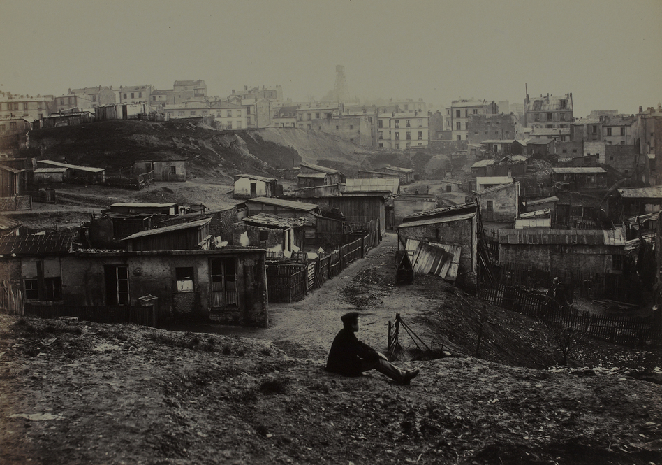Marville made more than 425 photographs of the narrow streets and crumbling buildings of premodern Paris, including this view from the top of Rue Champlain in 1877-1878. (Charles Marville/Musee Carnavalet/Roger-Viollet)