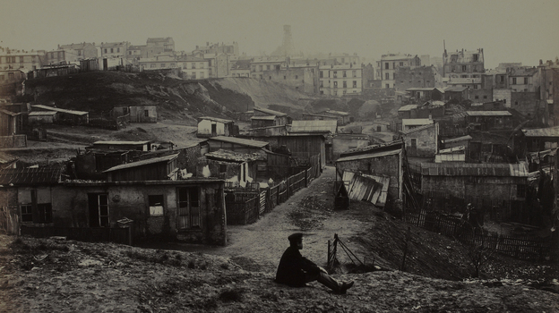 Marville made more than 425 photographs of the narrow streets and crumbling buildings of premodern Paris, including this view from the top of Rue Champlain in 1877-1878. (Musee Carnavalet/Roger-Viollet)
