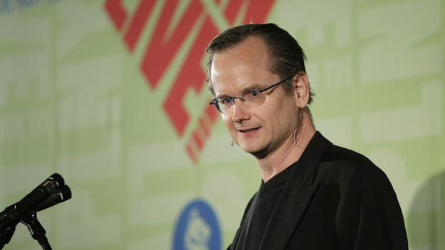 Law professor Lawrence Lessig, shown here in 2009, is suing an Australian record label for threatening to sue him over an alleged YouTube copyright violation. (Getty Images)