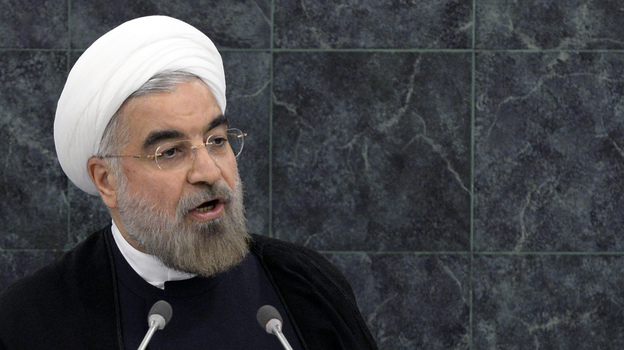 Iran's President Hasan Rouhani speaks at the U.N. General Assembly on Tuesday. With his outreach to the West, he received mostly positive reviews in the U.S., and most Iranians, who are being squeezed by sanctions, also appear supportive. (AP)