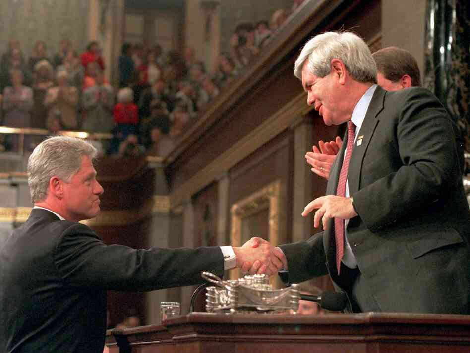 President Clinton shakes hands with House Speaker Newt Gingrich