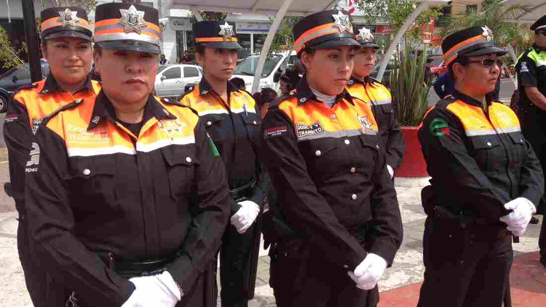 Dressed in the black and neon orange colors of the new transit police, these women are slated to replace a force of notoriously corrupt traffic cops in Mexico State.