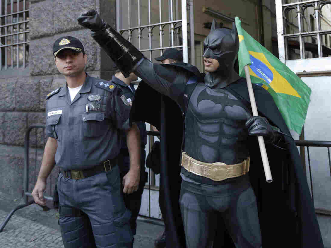 An anti-government demonstrator dressed as  Batman carries a Brazilian flag at a protest during Brazil's Independence Day celebrations in Rio de Janeiro earlier this month. The protesters called on the government to provide better security, education, health and public services.