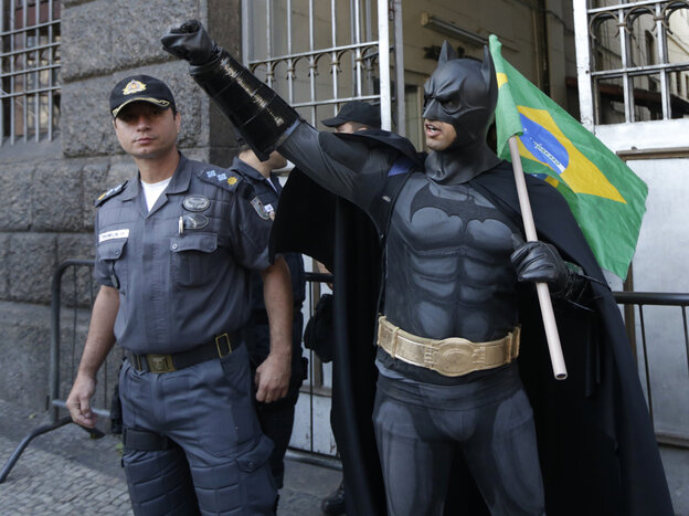 An anti-government demonstrator dressed as  Batman carries a Brazilian flag at a protest during Brazil's Independence Day celebrations in Rio de Janeiro earlier this month. The protesters called on the government to provide better security, educa