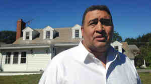 Former NFL offensive lineman Brian Holloway in front of his home in Stephentown, N.Y., which teens trashed earlier this month.