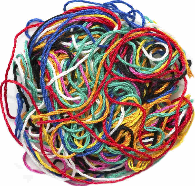 A colorful, tangled ball of yarn or thread.