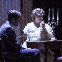 Zachary Quinto (left), Cherry Jones, Brian J. Smith and Celia Keenan-Bolger in The Glass Menagerie, which leaves out some of the elements -- such as walls -- you might expect in its St. Louis apartment set. The suggestive minimalism of the design is in keeping with the approach Tennessee Williams called for in his extensive stage directions.