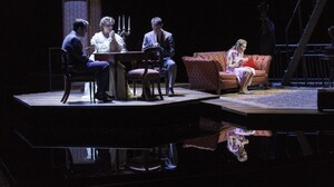 Zachary Quinto (left), Cherry Jones, Brian J. Smith and Celia Keenan-Bolger in The Glass Menagerie, which leaves out some of the elements — such as walls — you might expect in its St. Louis apartment set. The suggestive minimalism of the design is in keeping with the approach Tennessee Williams called for in his extensive stage directions.