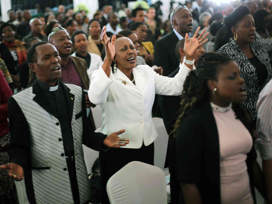 Friends and relatives of Mbugua Mwangi and his fiancee Rosemary Wahito attended their funeral service Friday in Nairobi, Kenya. Mwangi, who was Kenyan President Uhuru Kenyatta's nephew, and Wahito di