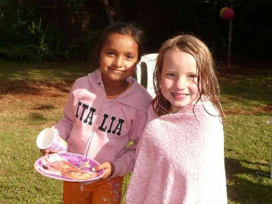 The author's daughter, right, with her friend Banita. The two girls lived