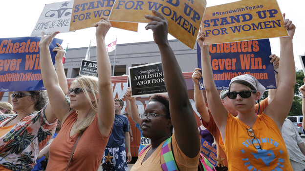 Women's health clinics have sued the state of Texas over its new abortion law, which they say will close more than a third of abortion providers in the state. Here, advocates for and