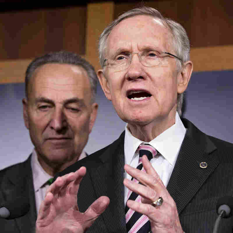 """Senate Majority Leader Harry Reid, accompanied by Sen. Charles Schumer, D-N.Y., tells reporters that Republicans need to """"get a life and talk about something"""" other than Obamacare."""