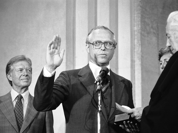 With President Jimmy Carter watching, Benjamin Civiletti is sworn in by Chief Justice Warren Burger as U.S. attorney general on Aug. 16, 1979. The following year, Civiletti issued a legal opinion saying that federal work cannot go on until Congress agrees to pay for it.