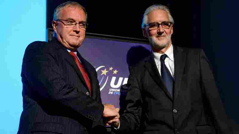 The incoming president of the International Cycling Union, Brian Cookson (right), shakes hands earlier this month with Pat McQuaid, the incumbent he defeated.