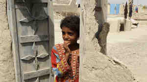 A Pakistani youth stands in the doorway of a damaged house in the devastated district of Awaran Wednesday. A powerful 6.8-magnitude earthquake struck the same region Saturday.