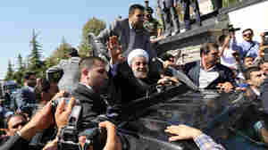 Iran's Rouhani Meets Protests And Cheers After Obama Chat