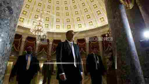 House Speaker John Boehner walks to the House floor on Saturday.