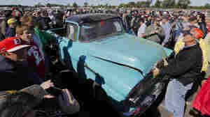 This 1958 Chevrolet Cameo pickup truck with 1.3 miles and a three-speed transmission sold for $140,000 at Saturday's auction of vehicles stockpiled for decades by car dealership owner Ray Lambrecht.